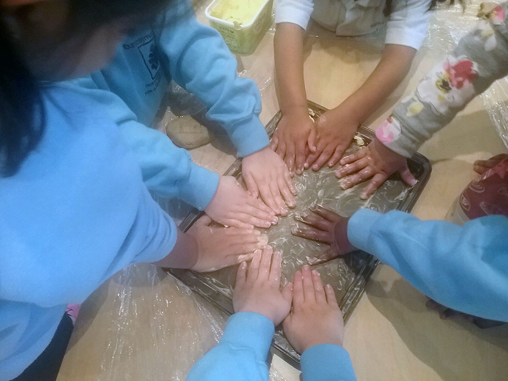 preschool children playing with their hands at a Preschool & Daycare Serving Colindale, Edgware & St Albans UK