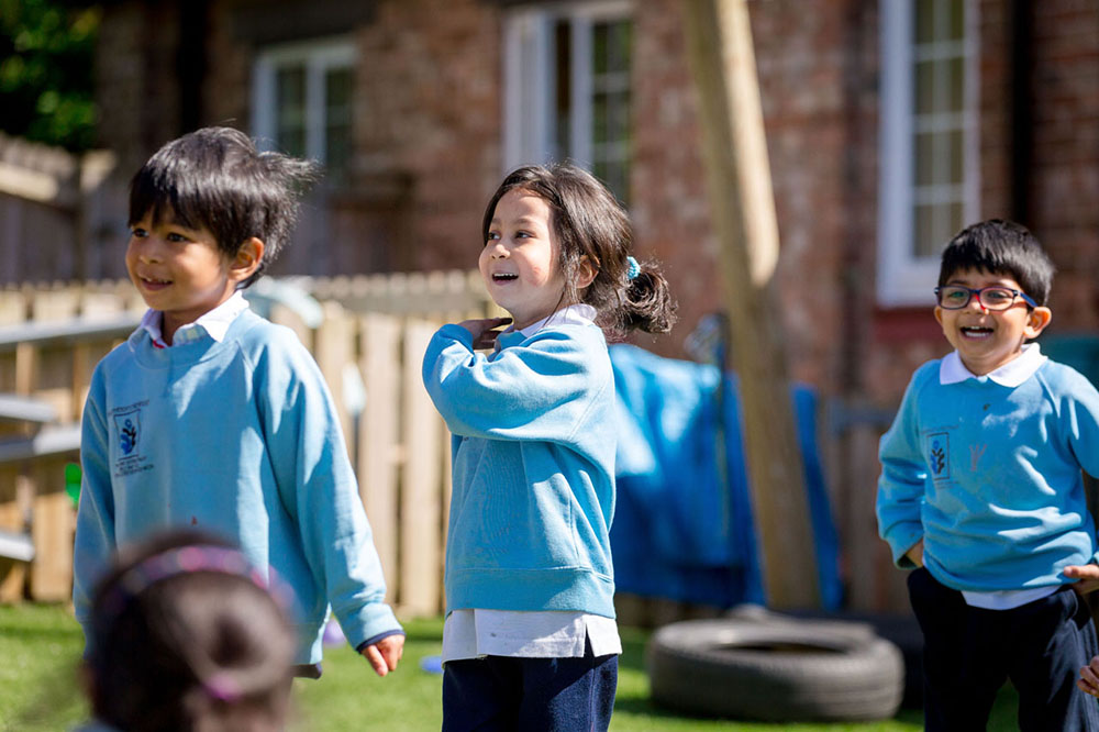 preschoolers enjoying sunshine outdoors at a Preschool & Daycare Serving Colindale, Edgware & St Albans UK