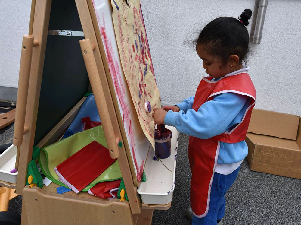 young toddler painting at a Preschool & Daycare Serving Colindale, Edgware & St Albans UK