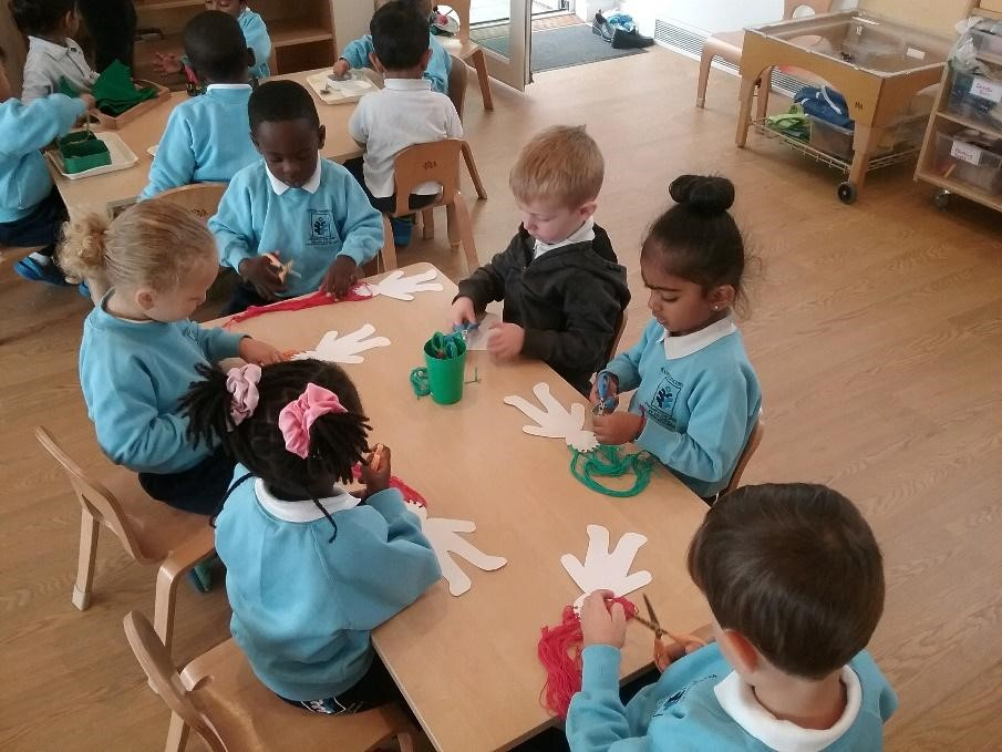 children at a desk working at a Montessori Pre-school and Nursery Serving Colindale, Edgware & St Albans UK