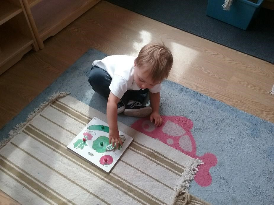 cute toddler playing on the floor at a Montessori Pre-school and Nursery Serving Colindale, Edgware & St Albans UK