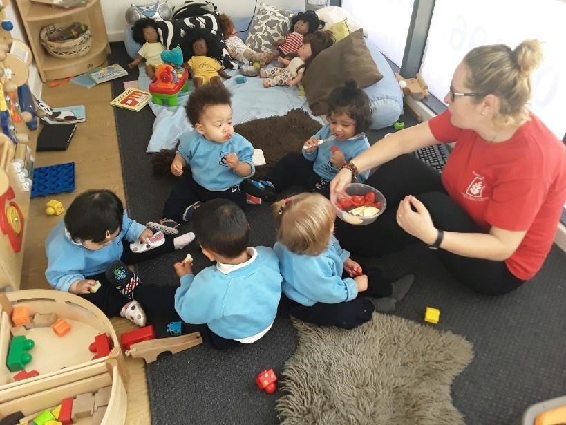 teacher and babies playing at a Montessori Pre-school and Nursery Serving Colindale, Edgware & St Albans UK